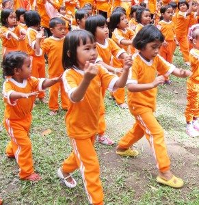 Children in the Better World program practice long exercise routines