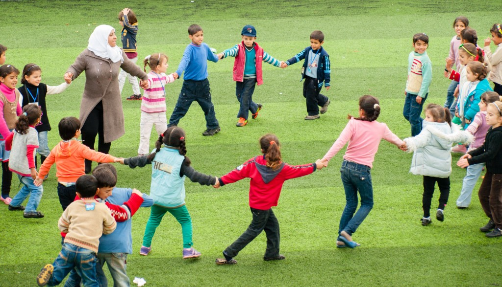 Group games in Child Friendly Spaces help refugee children feel normal again