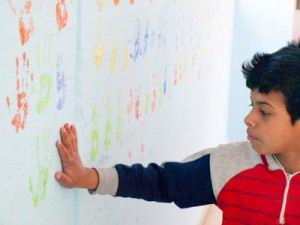 Refugee child making his mark