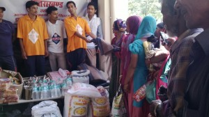 AMURT volunteers distribute food and non-food items to flood affected population